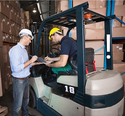 forklift-driver-sat-on-forklift-talking-with-foreman