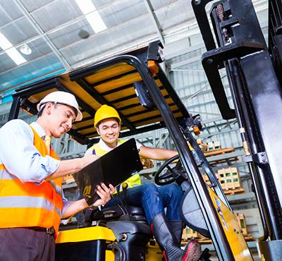 forklift-driver-sat-on-forklift-talking-with-team-leader